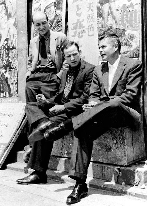 Glenn Ford and Marlon Brando have a chat (with director Daniel Mann standing next to them) on the set of The Teahouse of the August Moon, Japan, 1956.
