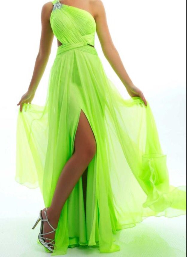 Neon lime green long flowy dress with side leg cut out, side exposed skin and crisscross designs with half neckline and jewels on top