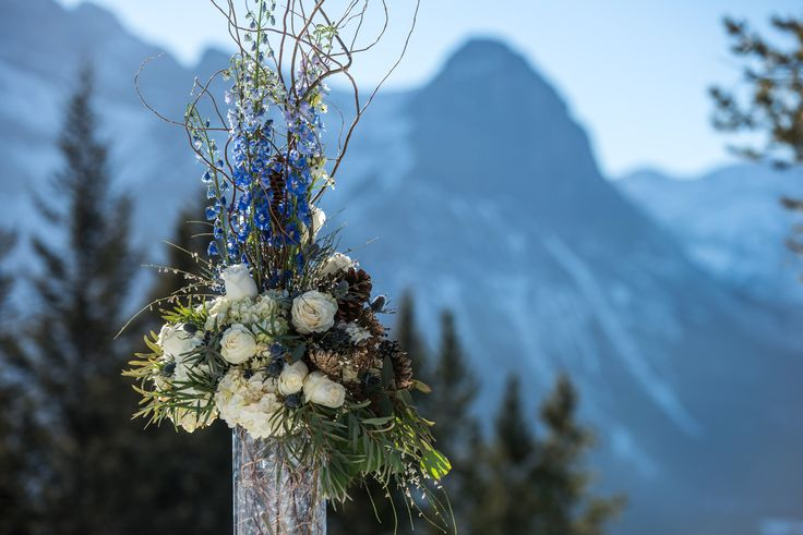 Colbalt blues & ivory flowers in this beautiful statement floral piece taken on location at @Silvertip Resort by @One Edition  Flowers by Janie, Calgary & Canmore Wedding Florist Rockies weddings