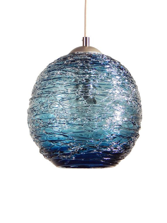 You are viewing a OOAK blown glass pendant lamp. This lamp is textured with a spun glass exterior. Clear glass over a steel blue base.   I