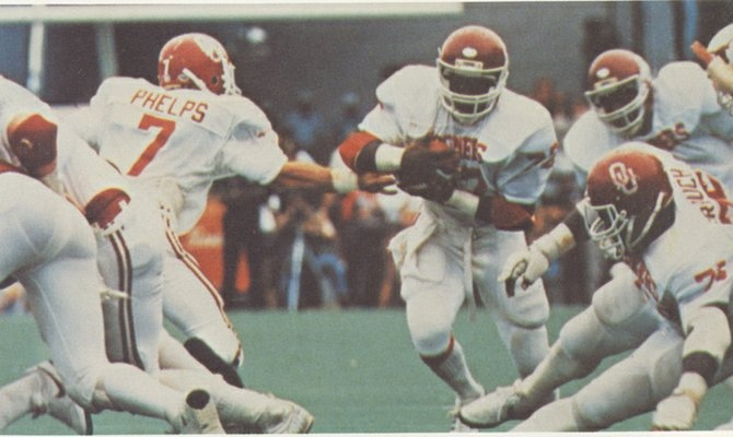 Stanley Wilson takes a hand-off from quarterback Kelly Phelps at the 1981 OU/Texas game.