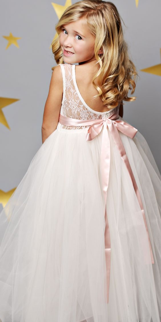 Get the cutest Flower Girl Dresses that will surely complete your Wedding Day.