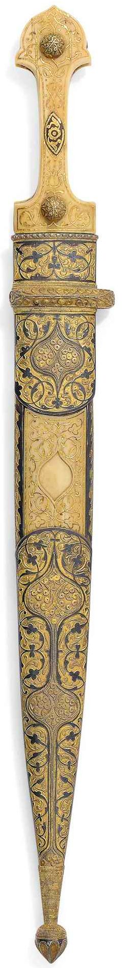 "Ottoman (Caucasus) qama / kindjal dagger, dated AH1292 (1875-6), of typical form, the hilt and scabbard finely worked with dense floral arabesques, the mounts with delicate silver-gilt filigree medallions, the hilt with applied filigree bosses, the hilt and scabbard signed ""Majid Dhimmi"" (?), with the name of the owner ""Muhammad Ibrahim Khan"" in gold overlaid on the blade, 19 1/8in. (48.7cm.) long."