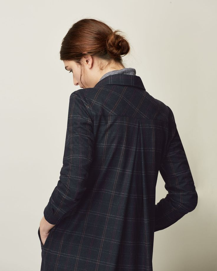 Overshirt-style, button-through dress in a warm, mid-weight wool blend. Knee-length and neat-ish. Inverted box pleat into back yoke. Welt pockets. Smoke mother-of-pearl buttons. Double buttoned cuff.