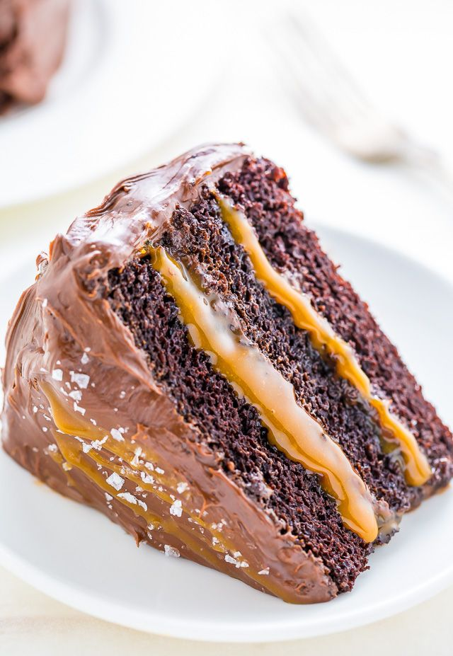 Three layers of Salted Caramel Chocolate Cake slathered in homemade Salted Caramel Chocolate Frosting.
