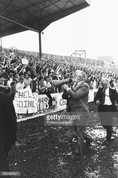 Chelsea chairman Ken Bates uses a tannoy to appeal to fans to stay off the pitch after the team won 5-0 against Leeds United to gain promotion to the First Division on April 28th 1984.