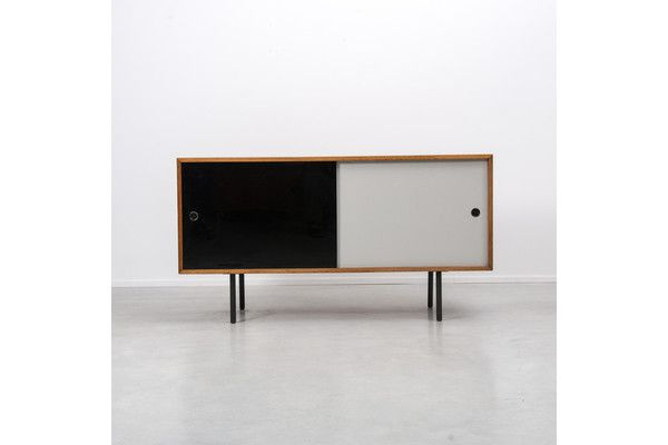 Robin Day Interplan Sideboard. A sideboard from the Interplan range by the leading British furniture designer of the post war era. Vitrolite glass sliding doors sit inside a mahogany veneered cabinet which sits on top of tubular metal legs. Very rarely seen on the market, an exceptional piece of museum quality design.