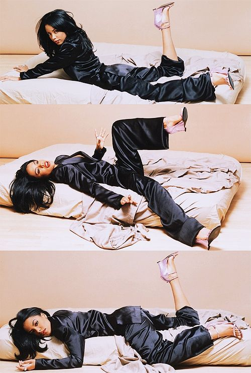 because aaliyah wearing silk pyjamas and tom ford for ysl heels is as close to perfection as you can get