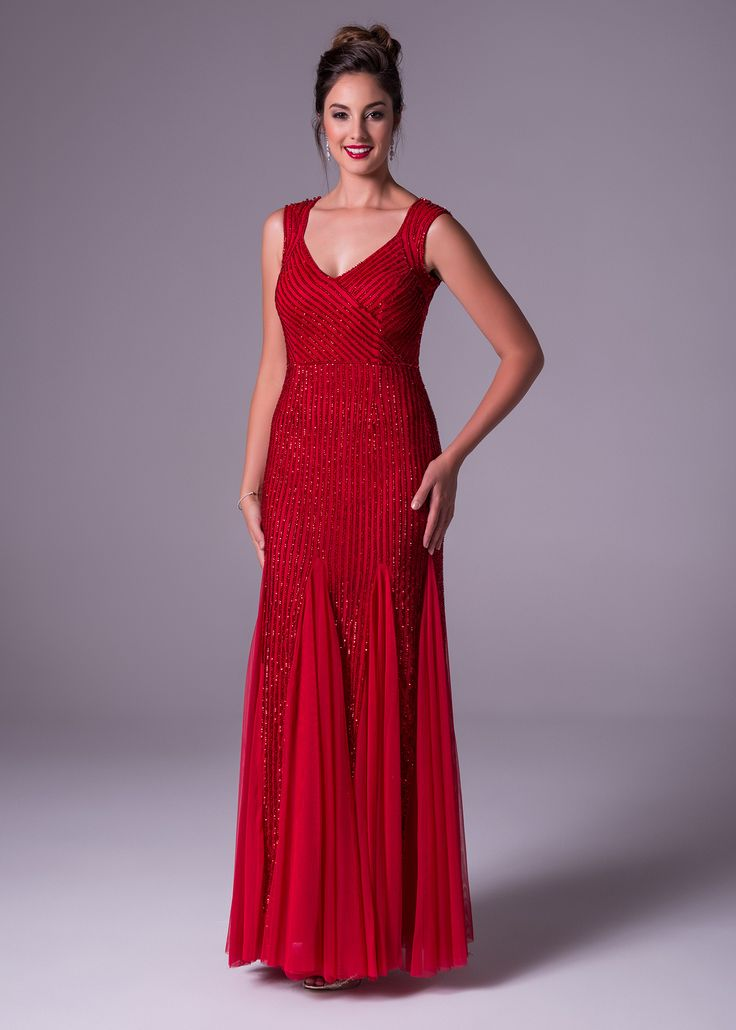 Red is such a statement colour. Be the center of attention in this fully beaded chiffon V-neck dress. With unique godet detailing on the skirt. Oleg Cassini available exclusively at Bride&co: http://www.brideandco.co.za/product/new-collection/wgin0015/
