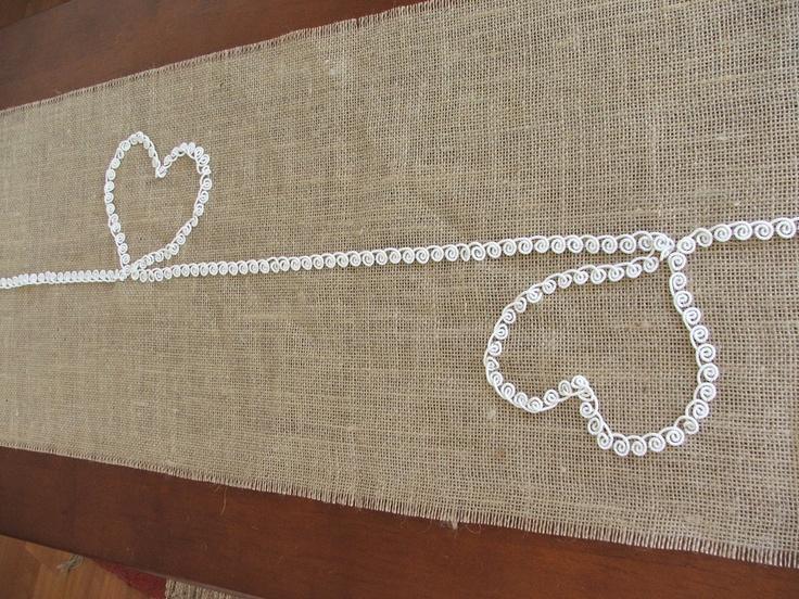Burlap table runner wit lace hearts wedding table runner Valentine's Day runner. $32,00, via Etsy.