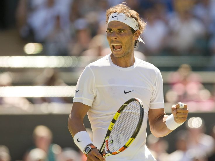 Spain's Rafael Nadal celebrates recording match point in his match against Thomaz Bellucci on day two of the Wimbledon Tennis Championships in London.  Susan Mullane, USA TODAY Sports