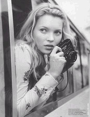 Kate Moss with a camera