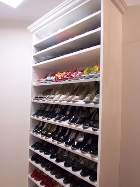 GREAT touch - clear plastic as front lip to shoe shelves