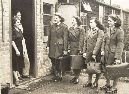 Land Army girls are welcomed on their arrival to work on a farm during the war.