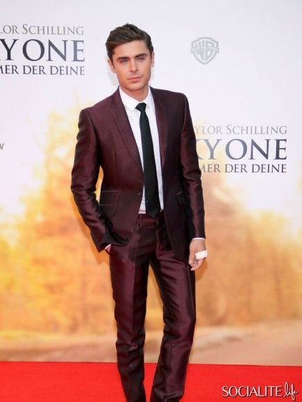 Zac Efron rocks a burgundy suit at the German premiere of 'The Lucky One'