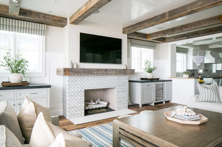 eliminate the bookcase tops and   excess drywall, add windows and it really sets the fireplace apart.  this tv area looks great..