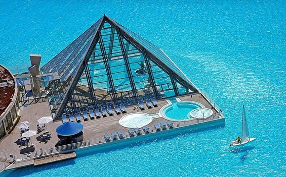 The BIGGEST Swimming pool in the world: The swimming pool at the resort San Alfonso del Mar in the Chilean city Algarobo, contains 250 million liters of clean seawater, which holds the record for the largest swimming pool in the world. Crystal Lagoon in Chile is large enough for sailing, and has its own artificial beach.