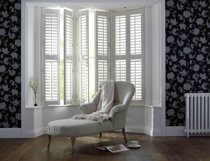 White full length shutters by Apollo Blinds. Black and white home decor. Modern window dressing. Contemporary inspiration for living room decor.
