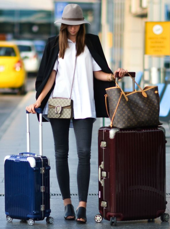 Barbora Ondrackova + stays chic + smart + crisp white shirt + dark grey skinny jeans + fashionable slip on mules + structured hat.  Travel Outfits + Shirt: Topshop + Bag: Gucci + Mules: Avenue32