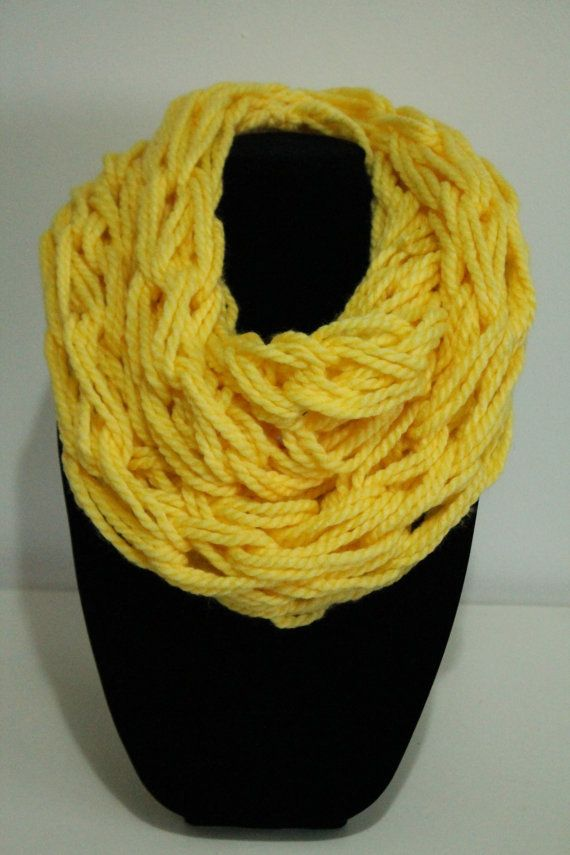 This arm knit scarf is made with multiple strands. It is very full. Wrap around twice nicely.