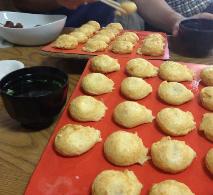 Akashiyaki (明石焼き)! It looks like a Takoyaki, but contains more eggs and is very soft  Of course it's got a cut piece of octopus inside.
