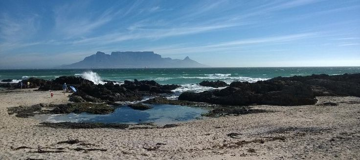 Spectacular Table Mountain on a summer day pictured from across the bay by Exclusive Getaways