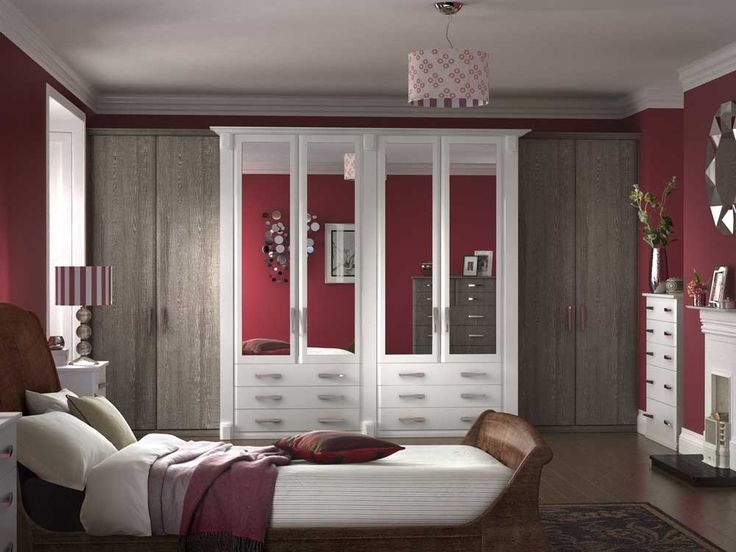 Bedroom Cupboard Design Ideas with white equipped four mirror paneled two double doors on six drawers by using satin nickel pull