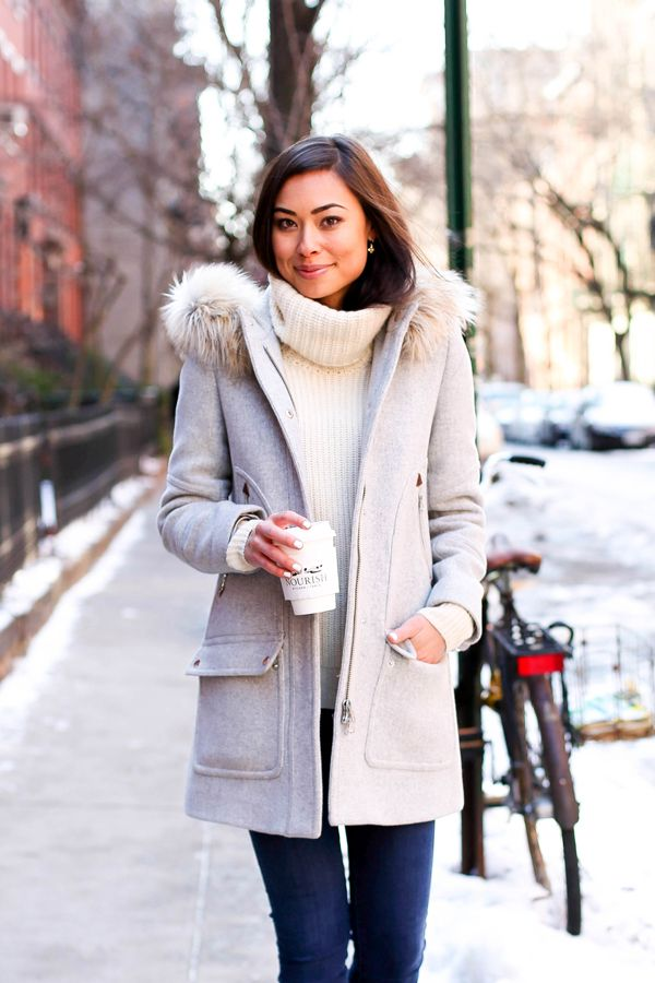 Grey winter coat with cream sweater.