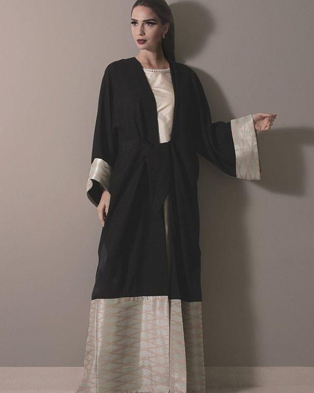 Shop abayas by Hessa AlFalasi // Haute-Elan.com Black Abaya with wavy Peach stripes. (Black Label - Only one piece)