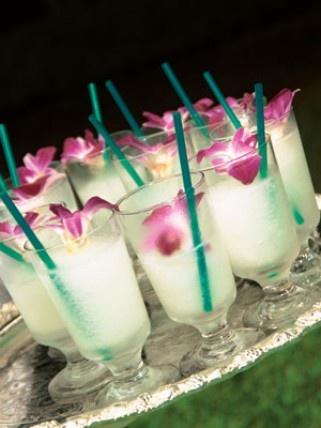 Hibiscus garnished luau drinks – The Knot