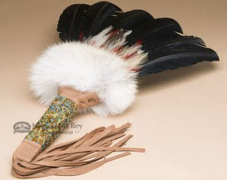 This is an authentic hand made Native American prayer fan. This beautiful fan has a beaded, leather wrapped handle and features genuine bar turkey feathers. Made by Creek Indian artists in the traditi