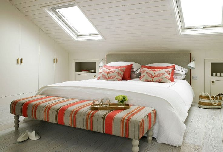 Skylights usher in ample ventilation while highlighting the slanted ceiling