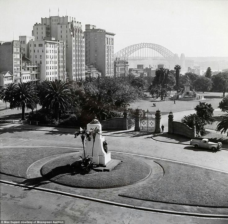 Macquarie Street entrance of the Sydney Botanical Gardens sits in the foreground (year unknown). •Max Dupain•