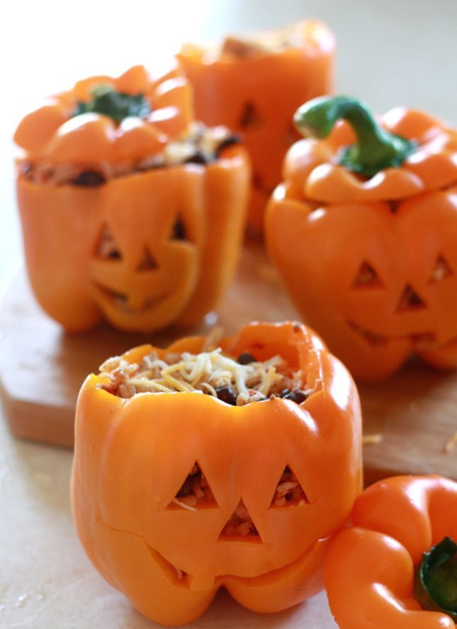 Make Shredded Chicken and Rice Stuffed Peppers in pumpkin containers with this easy make-ahead Halloween recipe.