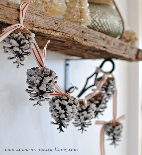 How to make a pine cone garland via Town and Country Living, DIY home decor, country chic, DIY holiday decor