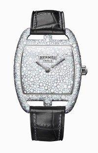 Hermès Uhr : Damenuhr - Extravagante Uhrentrends: Baselworld 2010  - Cape Code Armbanduhr © Hermès Uhr Cape Code Quartz-Uhr aus Weißgold, mit Diamanten besetzt. Armband aus Alligatorleder. Hermès www.hermes.com