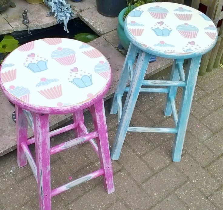 2x shabby chic kitchen stools,one blue and one pink with the tops Decoupaged with a Cupcakes design.