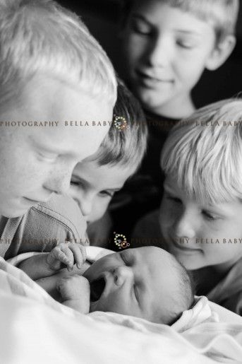 great shot of siblings with new baby