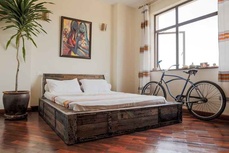 rustic industrial bed by rusty fundi