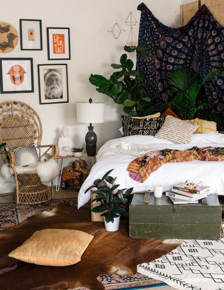 King bed in the corner with plants and tapestry behind it. Make a platform bed frame.
