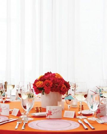 DIY bride, Cheree Berry adorned her reception tables with a bright dome of dahlias, zinnias, and roses.