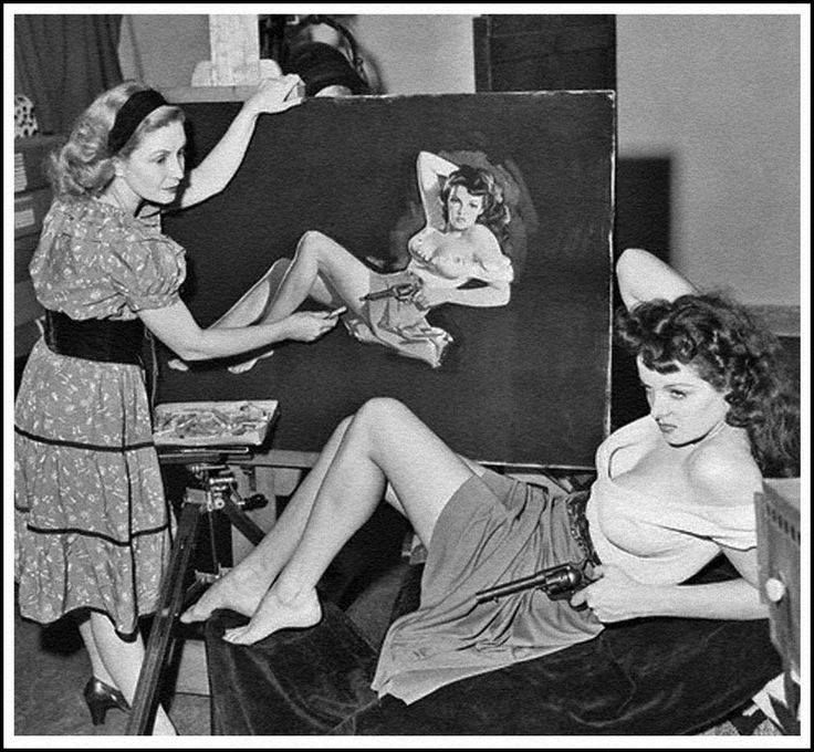 Publicity shot of artist Zoe Mozert painting Jane Russell for the movie The Outlaw 1943.