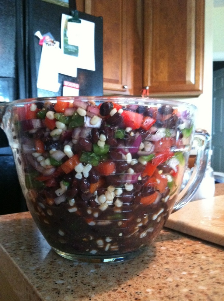 Black Bean Salsa    2 cans black beans, drained and rinsed    1 can shoepeg corn    2 peppers (preferably different colors for aesthetic purposes) chopped    2-3 tomatoes, choppped    1/2 red onion, chopped    1/4 cup cilantro, chopped    1/2 cup balsamic vinegar    2 tbs salt    1 tsp pepper