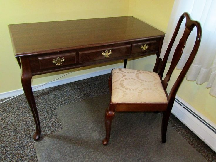 "Mahogany Queen Anne style desk and chair. Desk is 29.5""Tx47""Wx24""D, chair is 38.5""T. Both pieces have finish wear."