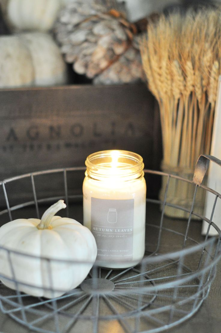 Autumn Leaves paired with wheat, pumpkins, and Magnolia = PERFECT Fragrance: The naturally fresh, woody smell of leaves in the brisk autumn air, this medley of birch and maple leaves with pomegranate, juniper berry, and orange blossom added to the blend, brings the glory of fall into your home. Beautifully handmade, scented soy mason jar candles - decor for the vintage inspired, modern farmhouse home.