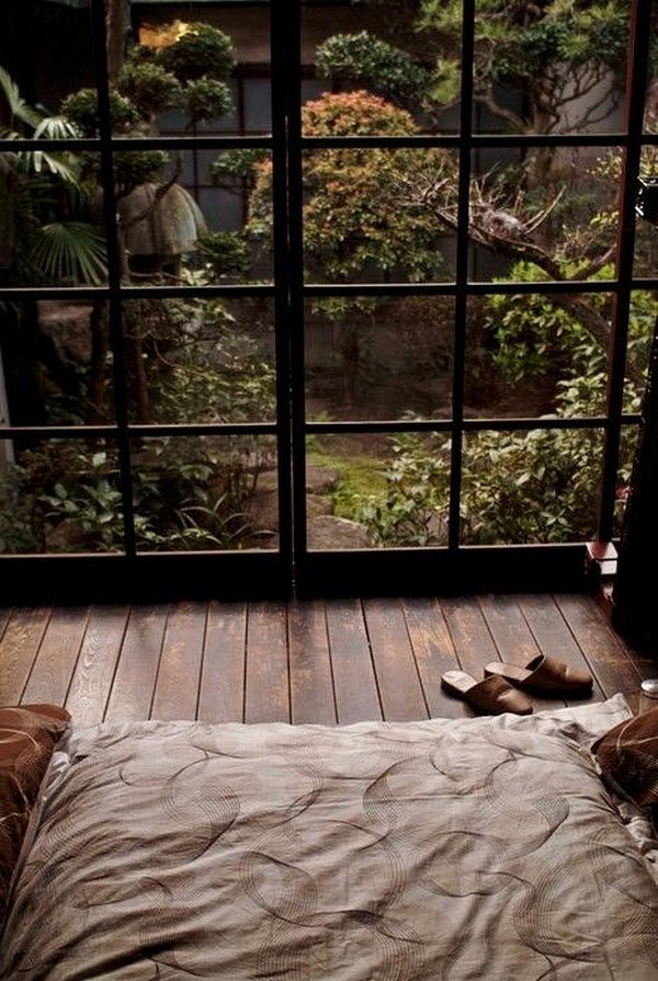 Love the relationship between the window, floor, and bed. And the view.