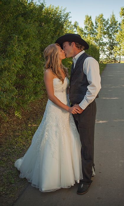 Amber found her dress - a Private Label by G gown with a sweetheart neckline and lace detailing - after trying on just three gowns. Shawn topped off his look with a 10-gallon black hat. Photo: José Paulo MPA