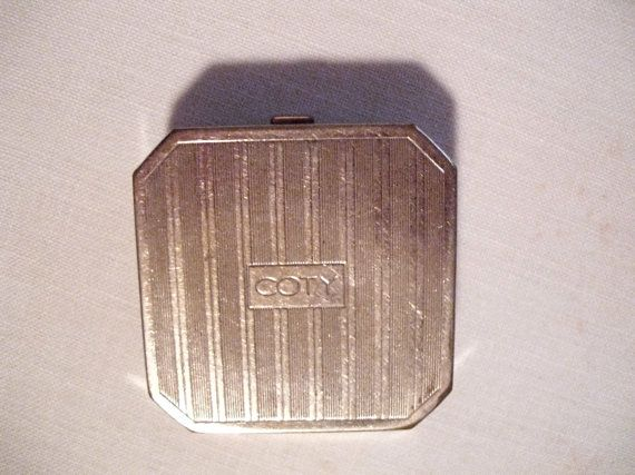 Vintage Coty compact or vanity case circa 1920-1930. The compact is octagonal shape and has a polished nickel finish. Art Deco design. Coty is on