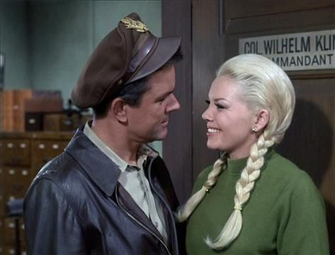 """Bob Crane & Sigrid Valdis Bob Crane as Col. Robert E. Hogan and Sigrid Valdis as Hilda in the """"Hogan's Heroes"""" episode, """"Praise the Fuhrer and Pass the Ammunition."""" Original air date, Jan. 20, 1967. Crane and Valdis were married from 1970 until Crane's death in 1978. (Getty Images / CBS)"""