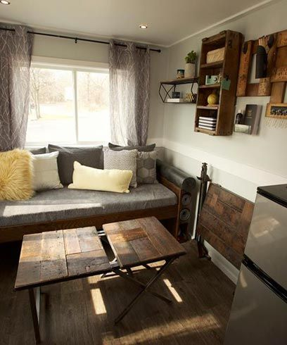 Reclaimed wood was used for the coffee table, wall decorations, and fold down table in the living room.